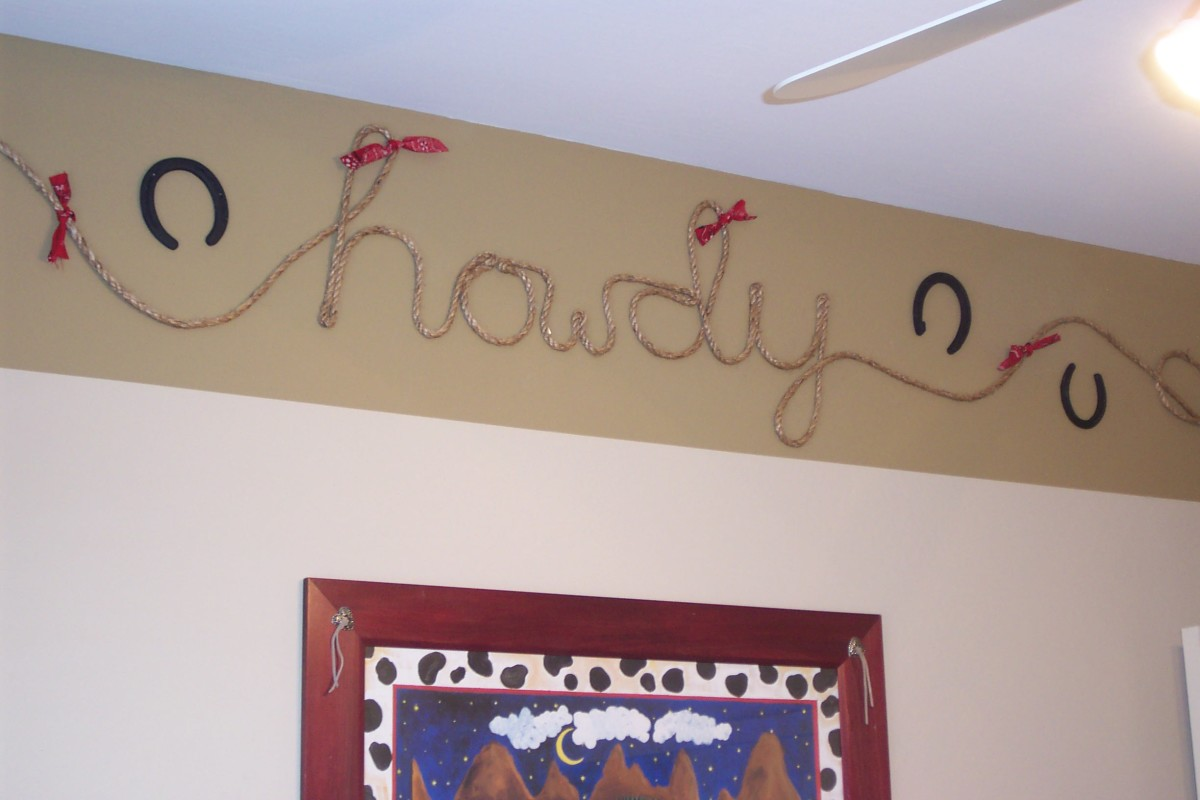 Rope, red bandanas, horse shoes, and paint came together nicely for a cowboy theme in my son's bedroom.