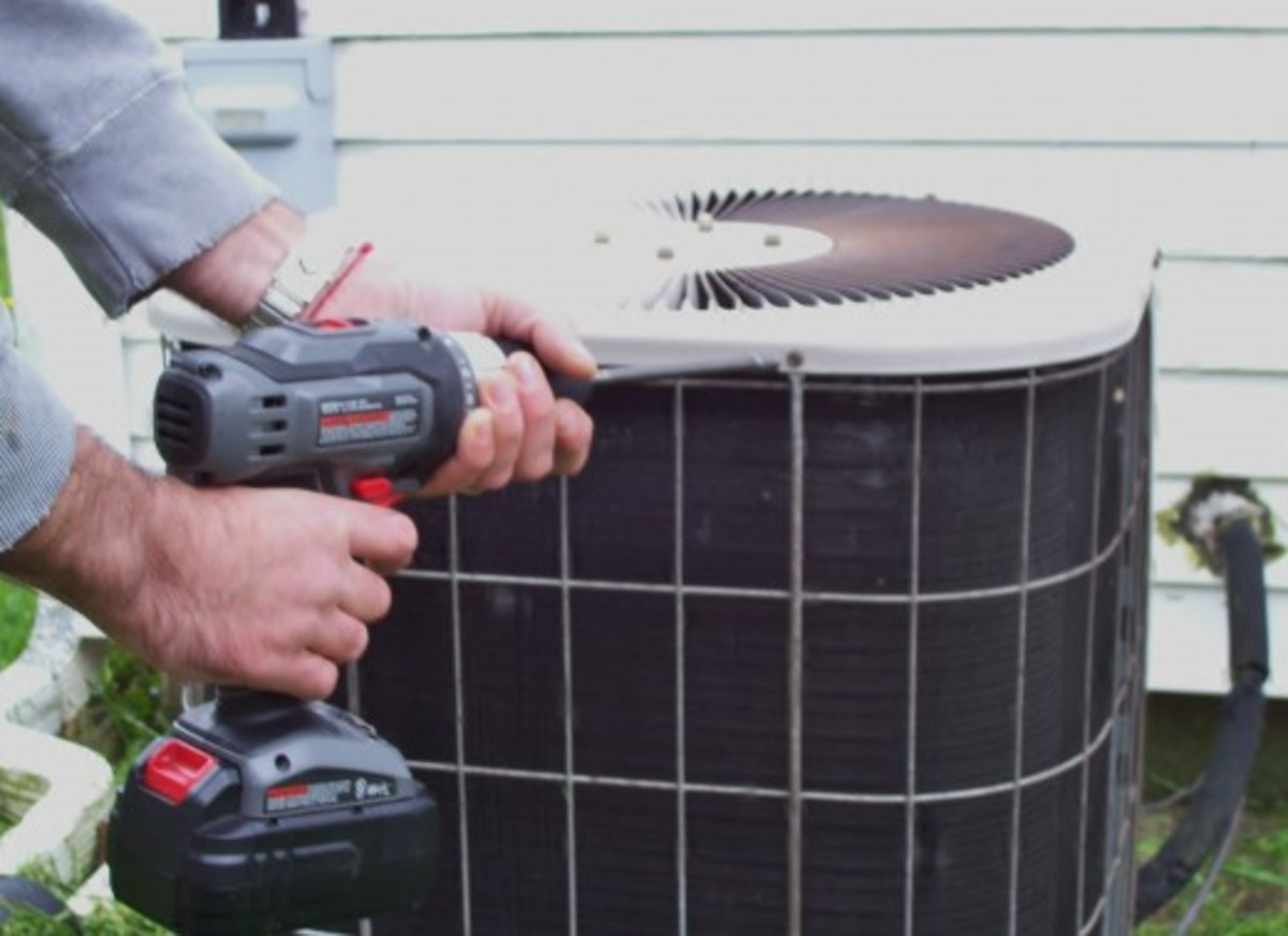 Use a screw driver to remove the screws holding the top of the condenser unit in place.