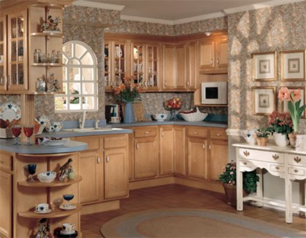 White microwave in kitchen with wood cabinets