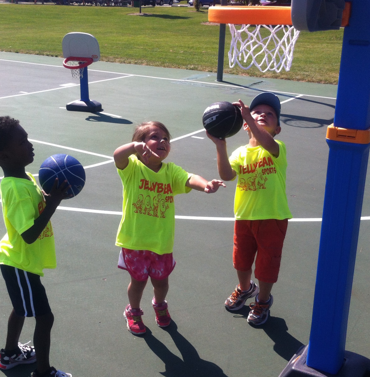 Kids shooting basketballs