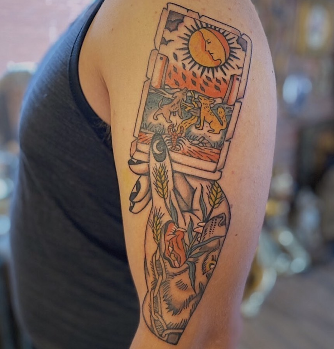 Tattoo by Caige Baker (@caigebaker on Instagram) in Calgary, Alberta (the Moon in the Rider-Waite Deck): Showing a card with the hand that drew it is an imaginative design choice.