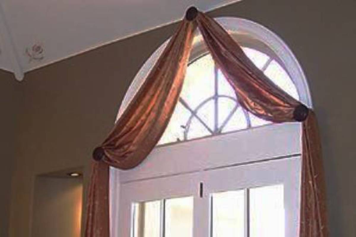 Scarves are lovely accents for window arches.