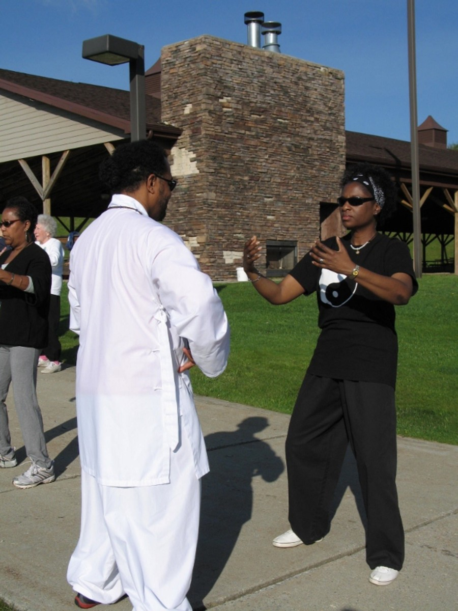 Laoshi instructs student at tai chi retreat in 2011.