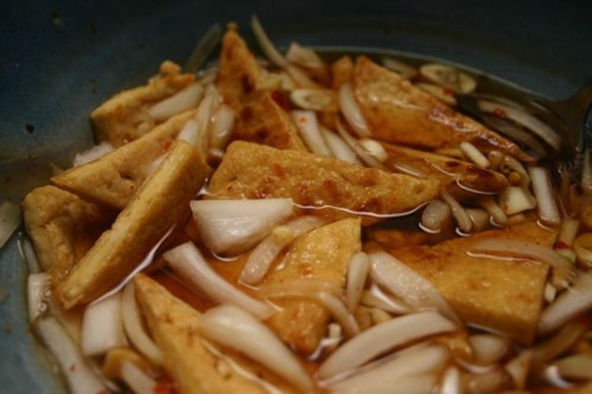 Dry-fried and marinated tofu, ready to be incorporated into your favorite stir-fry dish.