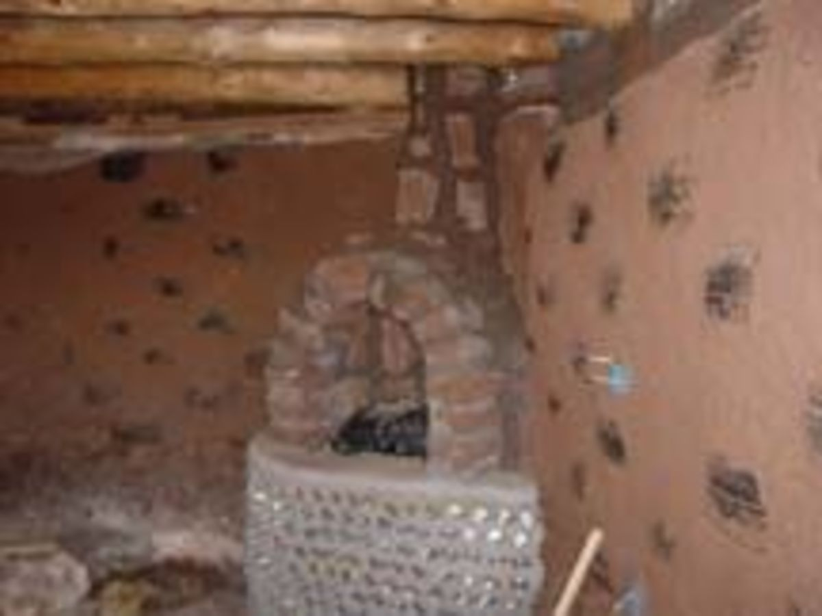 Building adobe fireplaces.