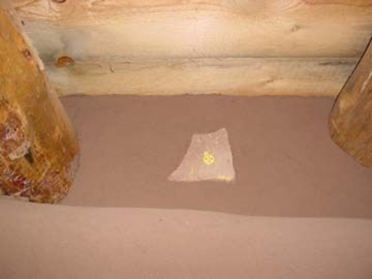 Mud application in bedroom:  Setting flagstone pictographs into wall.