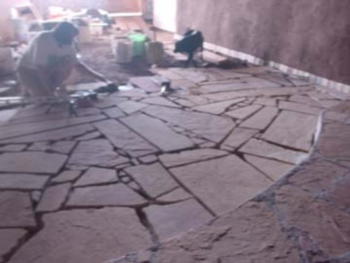 Laying flagstone floor.