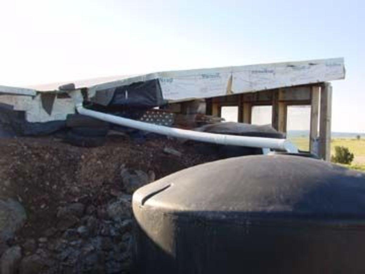 Exterior stucco & rainwater collection.
