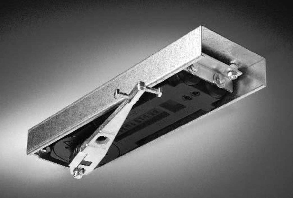 Concealed overhead door closer.