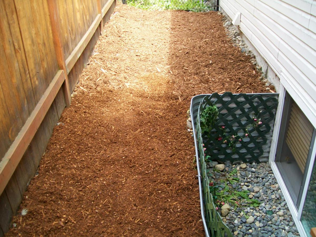 Covering with bark mulch.