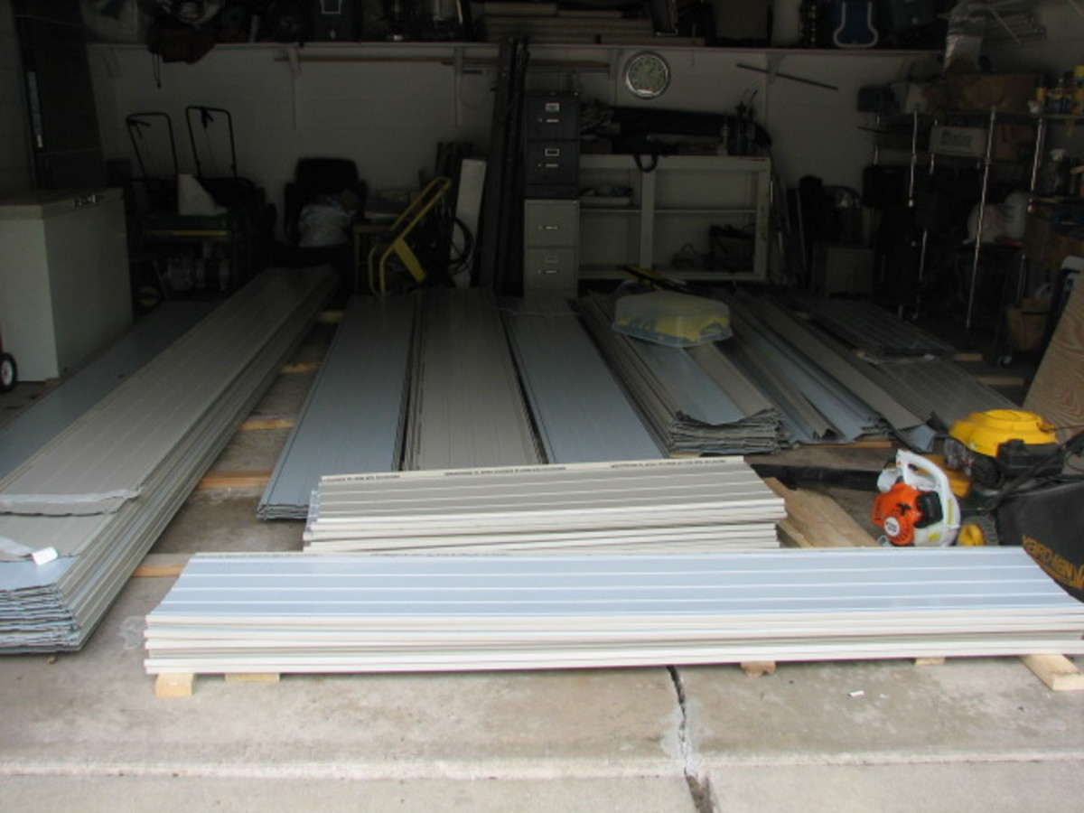 the steel roofing panels should be sorted and carefully stacked according to length