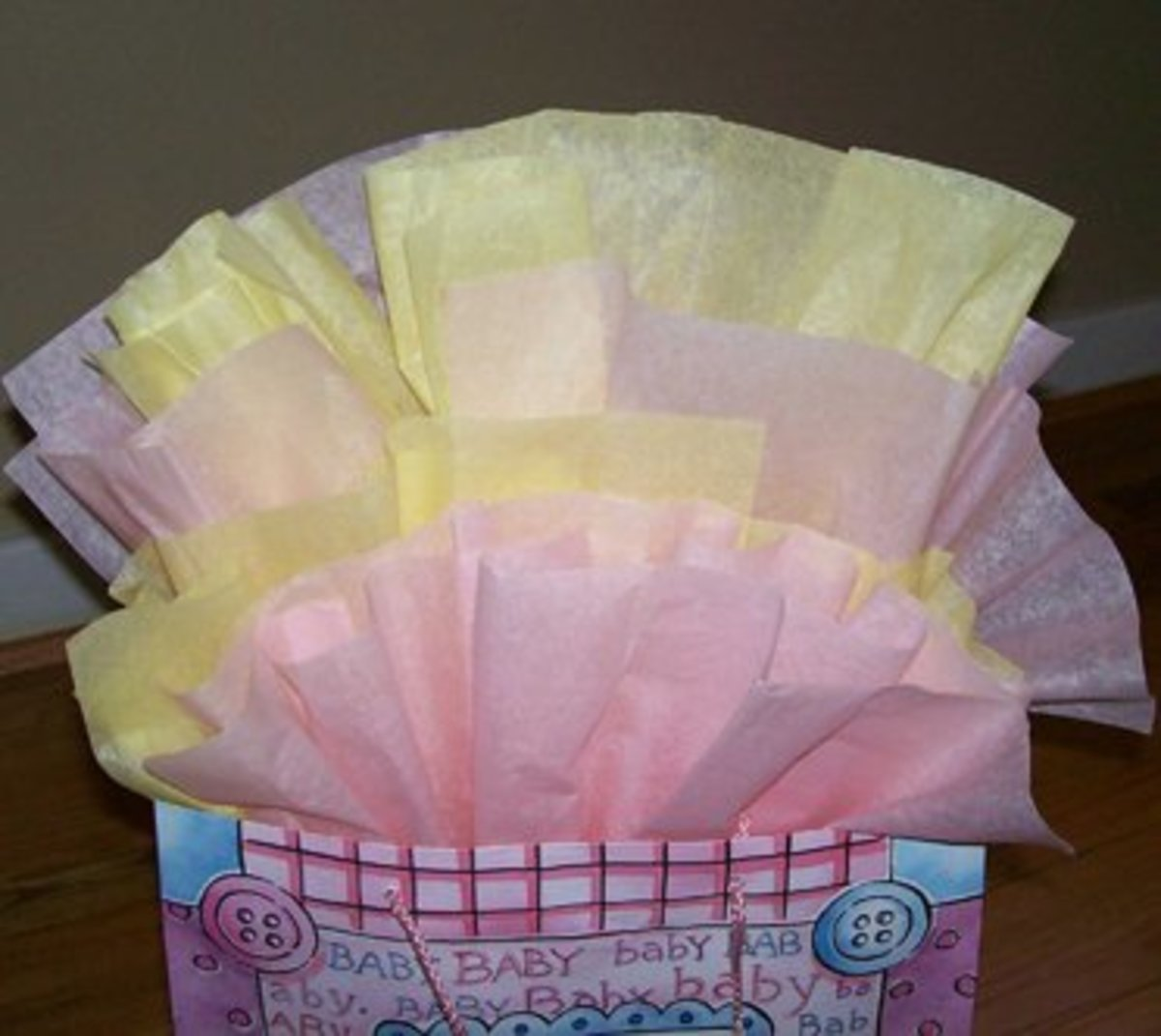 """This gift bag features tissue paper placed with the """"fan method."""""""