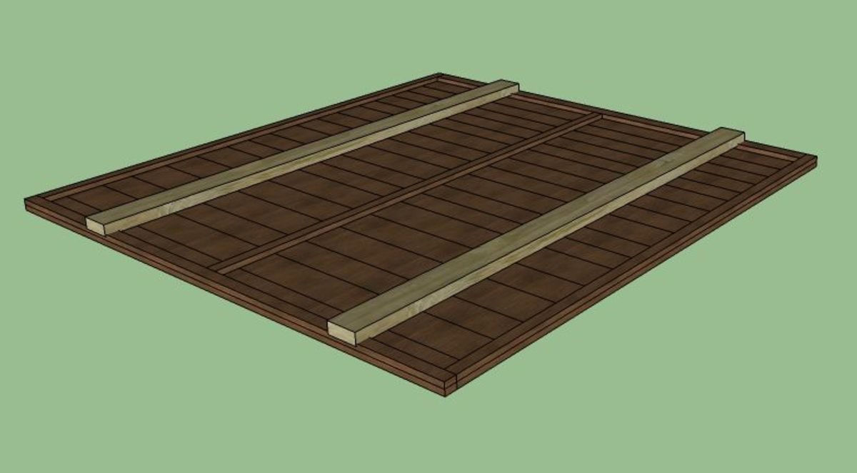 """The first step is to reinforce your fence panel. If it's anything like mine, then it will be pretty weak once it's been taken out from between the fence posts on either side. Lay your fence panel on the ground with its """"front"""" facing up."""
