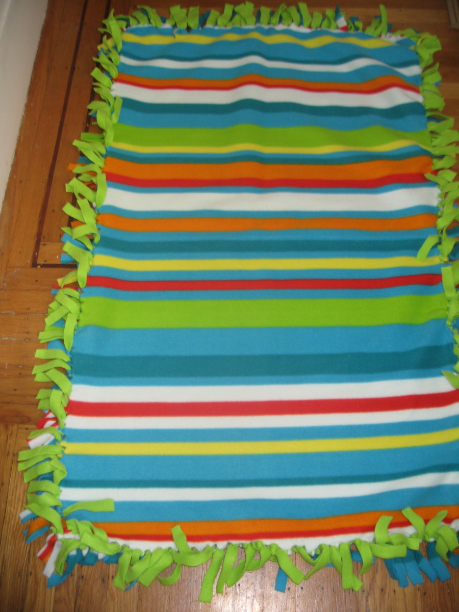 A complete tied fleece blanket.