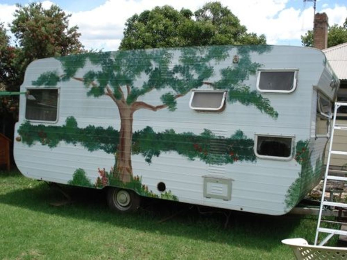 The back of the van with its painted garden.