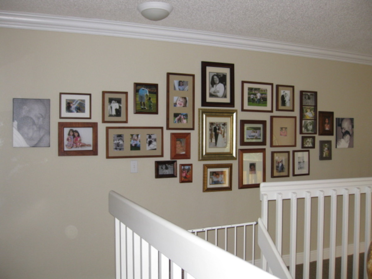 My family photo wall display.  I chose to use all gold and brown wood tones, with the exception of the two unframed canvas prints.  I have found that this overall shape is easily tweaked if I decide I want to add a couple more frames here and there.