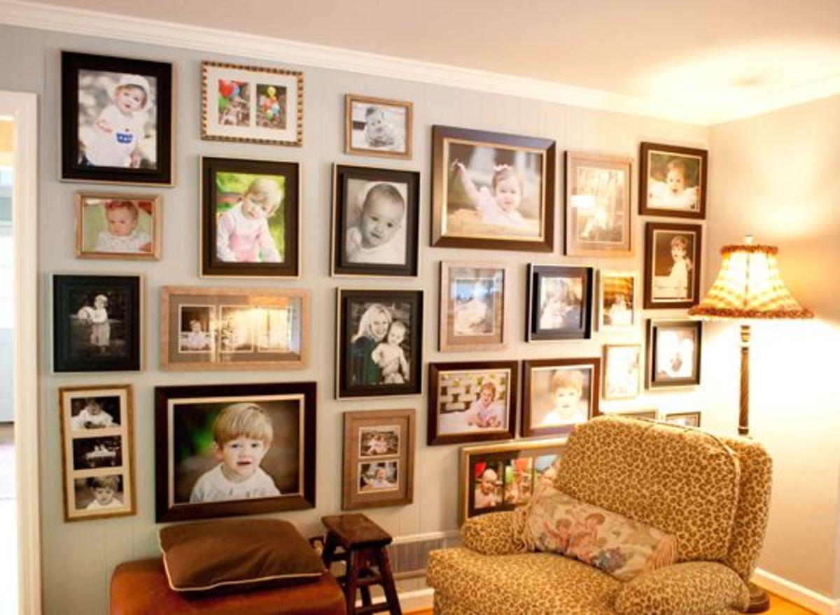 "Here's an example of not sticking with the traditional ""hang pictures (only) at eye level"" thinking - I think this photo wall is dramatic and exciting. I love it!"