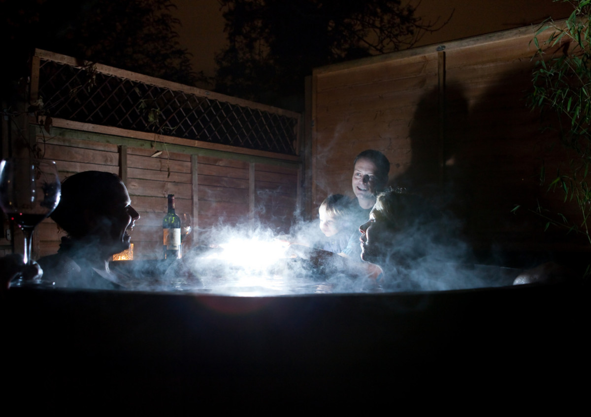 Hot tubbing at night, in the winter, with family and friends.