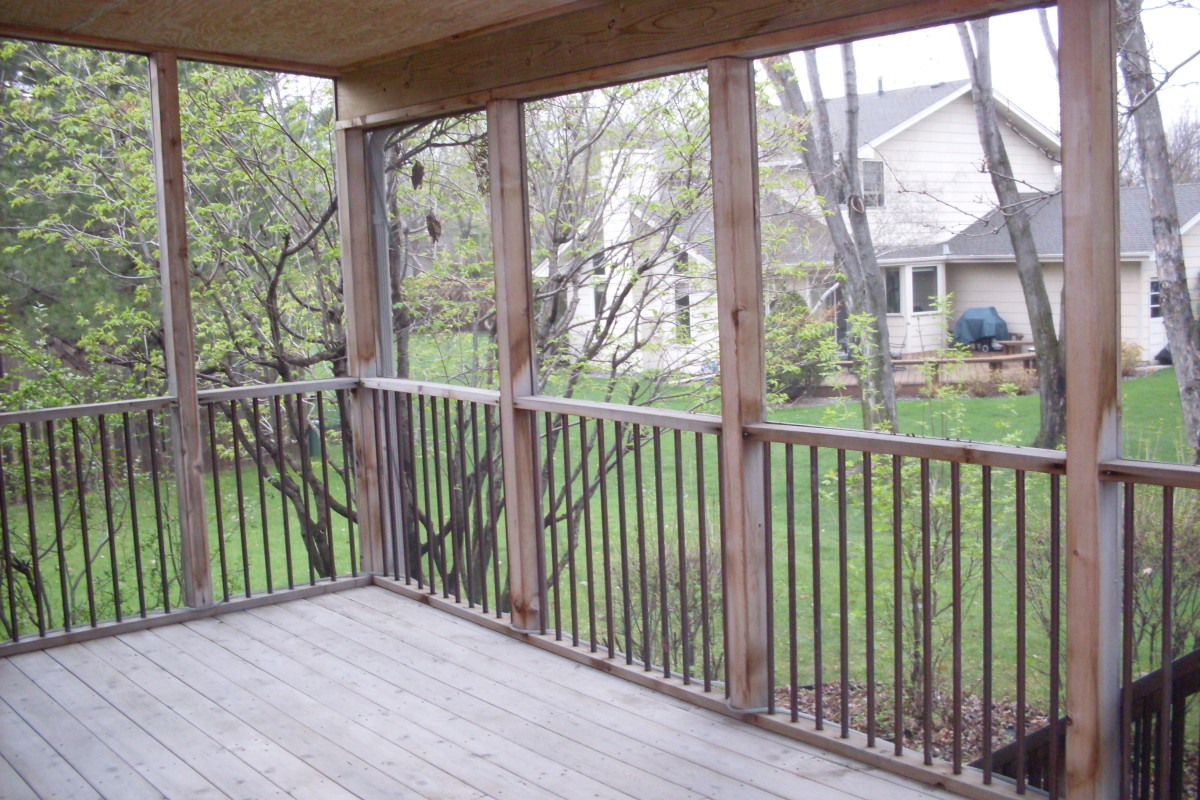 My deck, before cleaning with dish soap. You can almost smell the cedar in the air just looking at the photo.