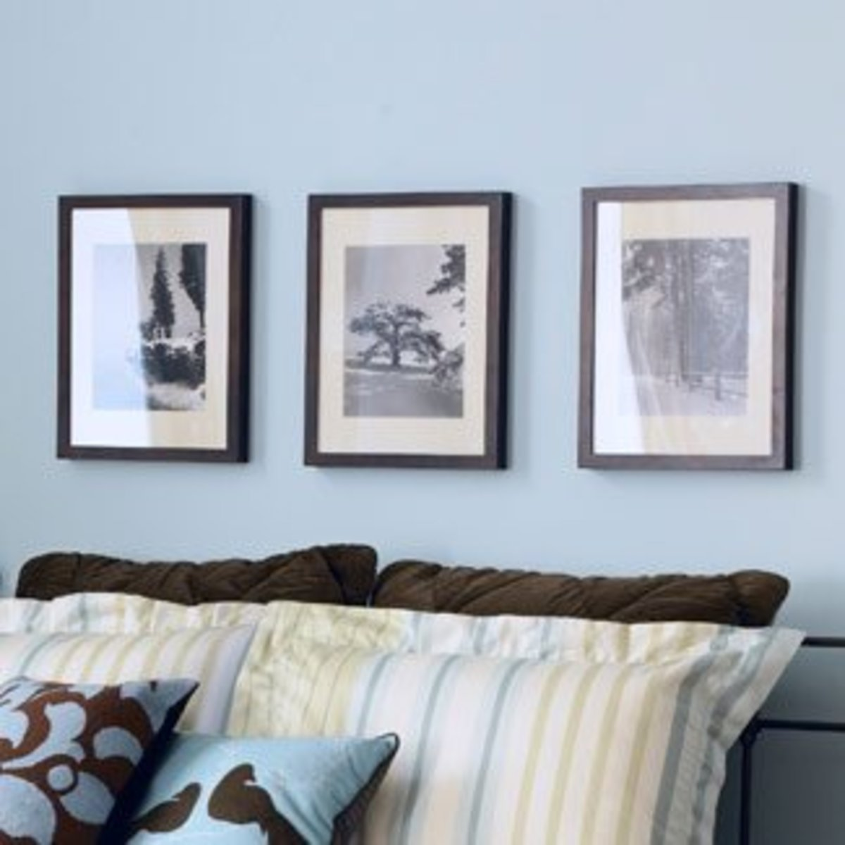 A simple picture hanging idea using three framed pictures/paintings, all set out in a straight line.