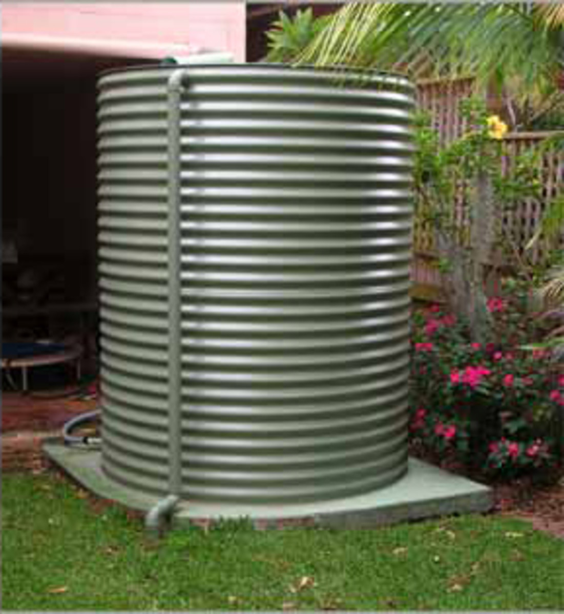 A nice little corrugated steel tank fitted into the garden environment.