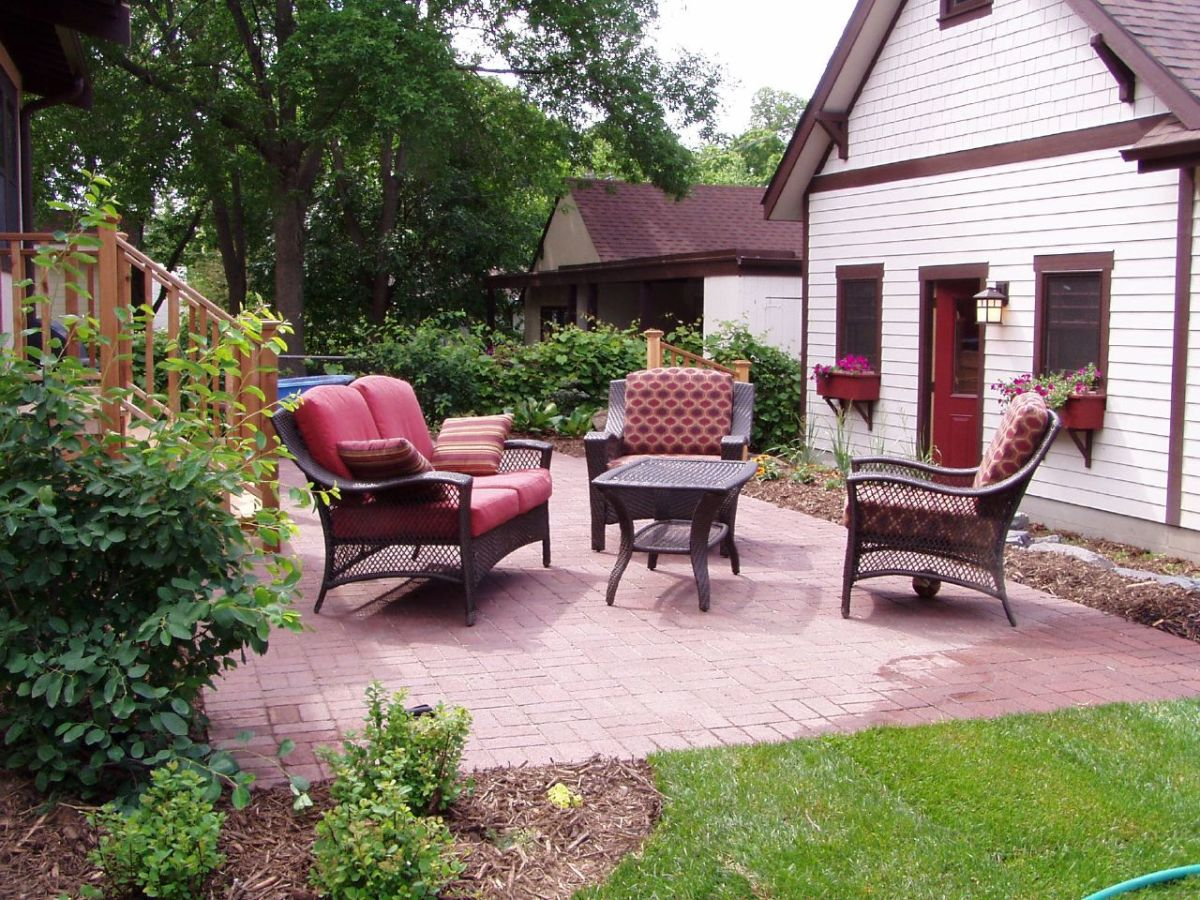 You always want to tilt your patio slightly away from the house to prevent pooling of water near your foundation.