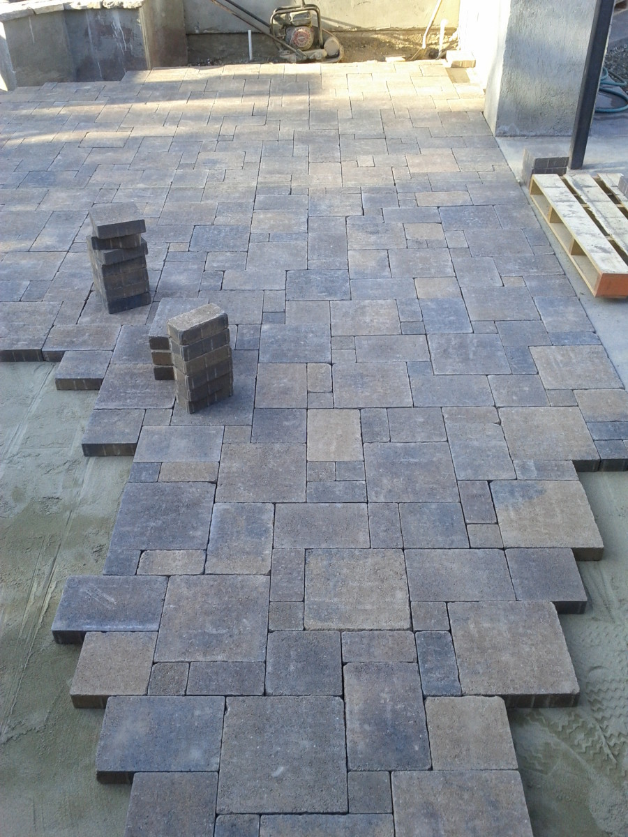 The layer of sand under the pavers acts like glue.