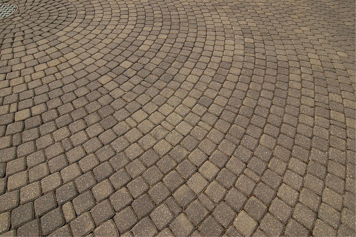 Concrete pavers in a circular pattern.