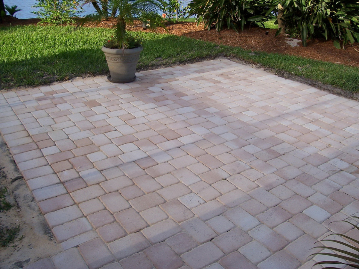 A simple paver patio can extend your existing concrete patio for a larger outdoor space.