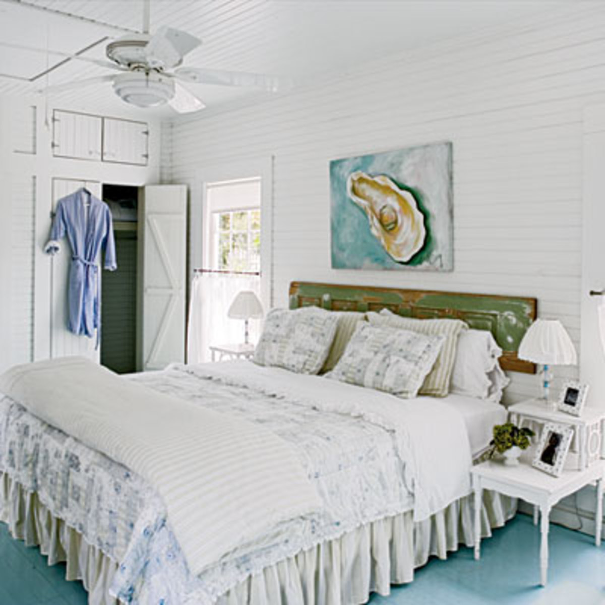 A re-purposed old door can add charm as a headboard. Add trim to give it more flair.