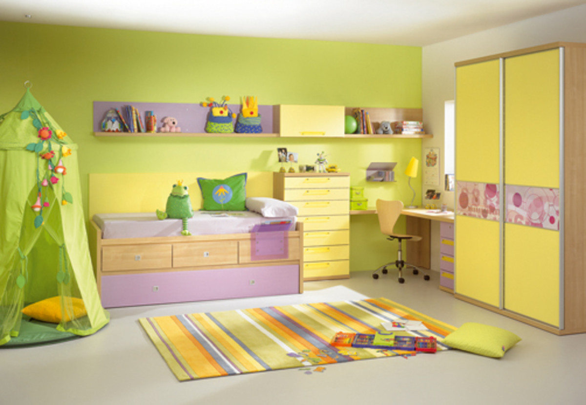 Here's a great example of the use of a bright color on one wall to add some fun to a child's room.