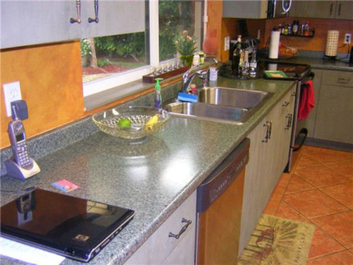 Ugly Formica Countertops And Faux Finished Laminate Cabinets.