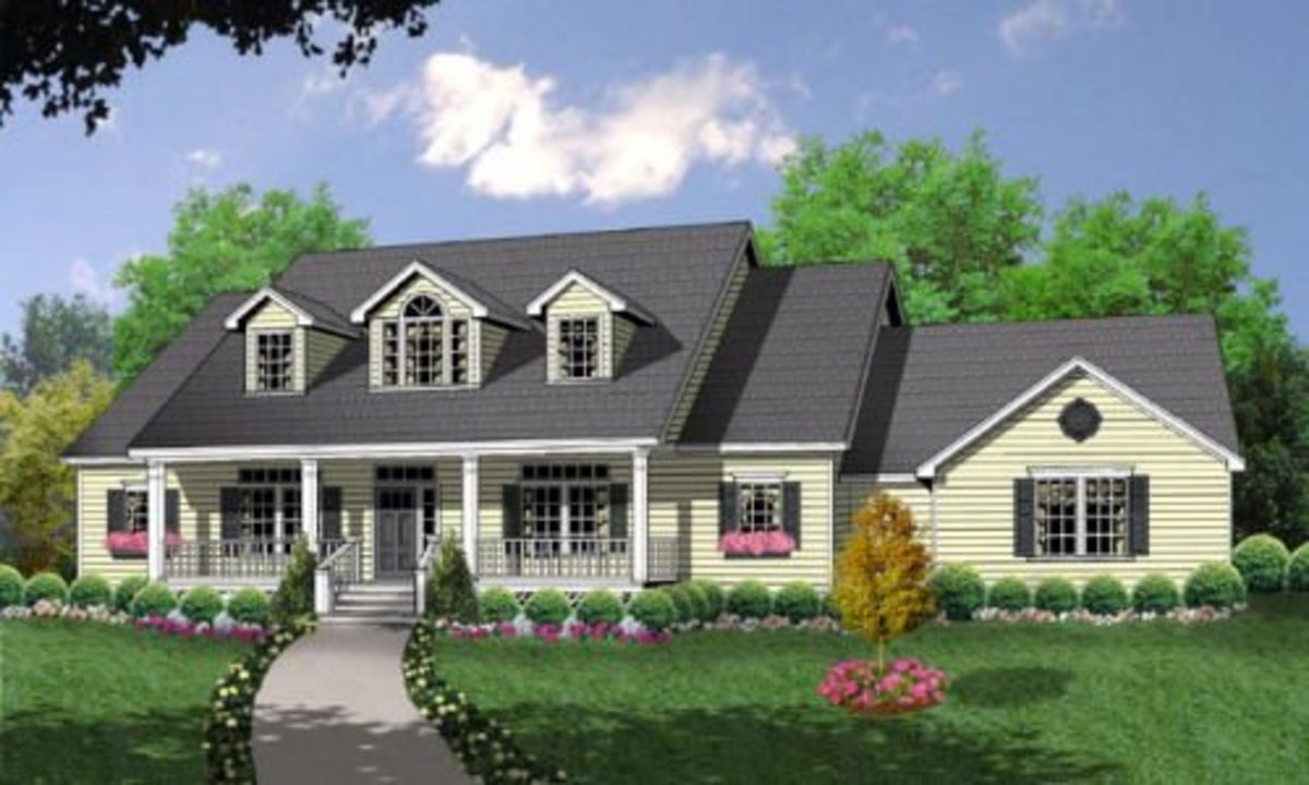 With three dormers, front porch, and attached garage.