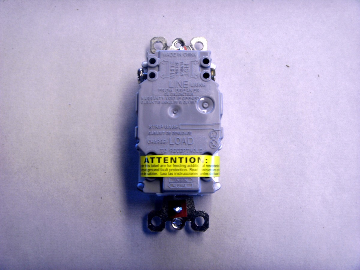 The back side of a GFCI outlet.
