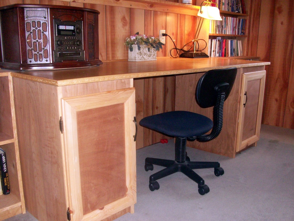 Sewing table showing cabinets as well.