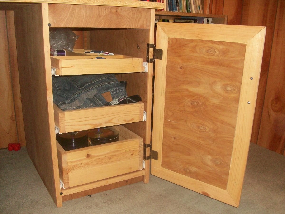 Right cabinet with door open.