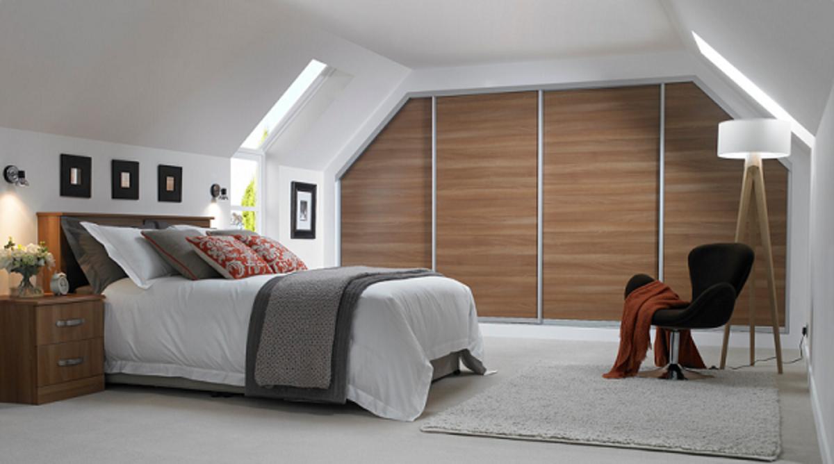 Sliding wardrobe units built into this minimalist theme alcove space.