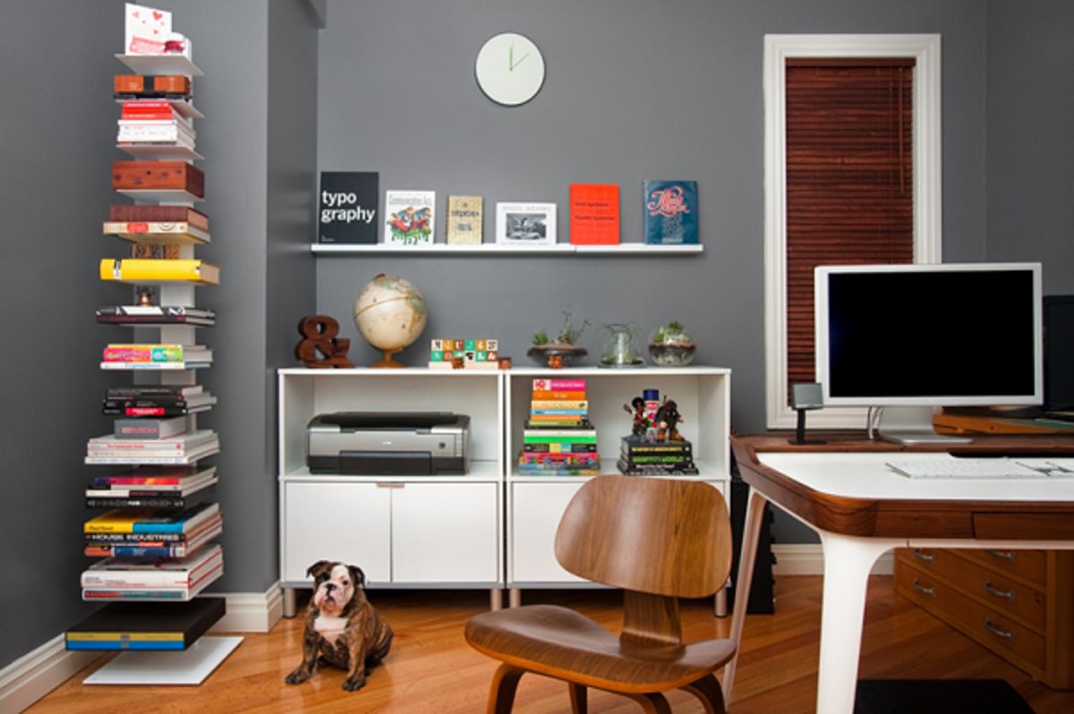 Utilizing a dead corner of a room with floating shelving—this is decorating a small space effectively.