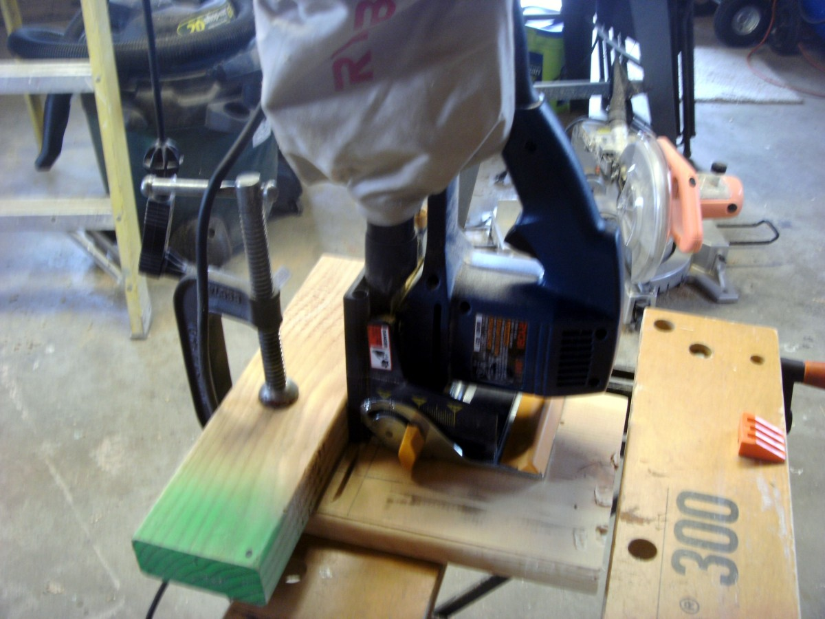 Using the biscuit jointer vertically against a temporary fence.