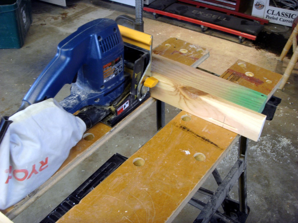 Using the biscuit joiner with the board held vertically against a fence.