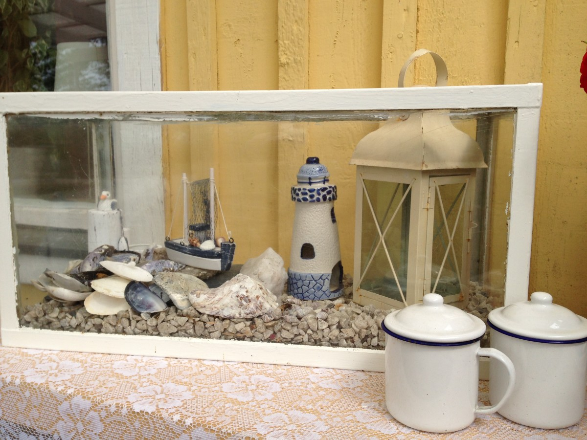 Use an old aquarium and decorate it with the things you like!