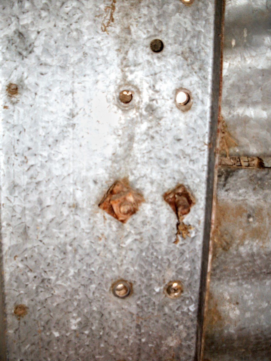 On many older bins, there are a variety of fasteners. Sometimes, they are rusted past loosening. You may need a torch for situations like this.