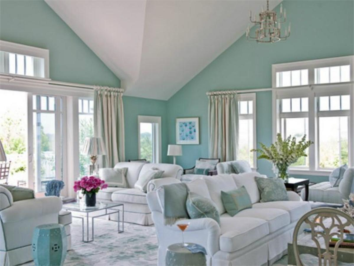 A beautiful and serene home décor idea with aqua blue walls and white furniture.