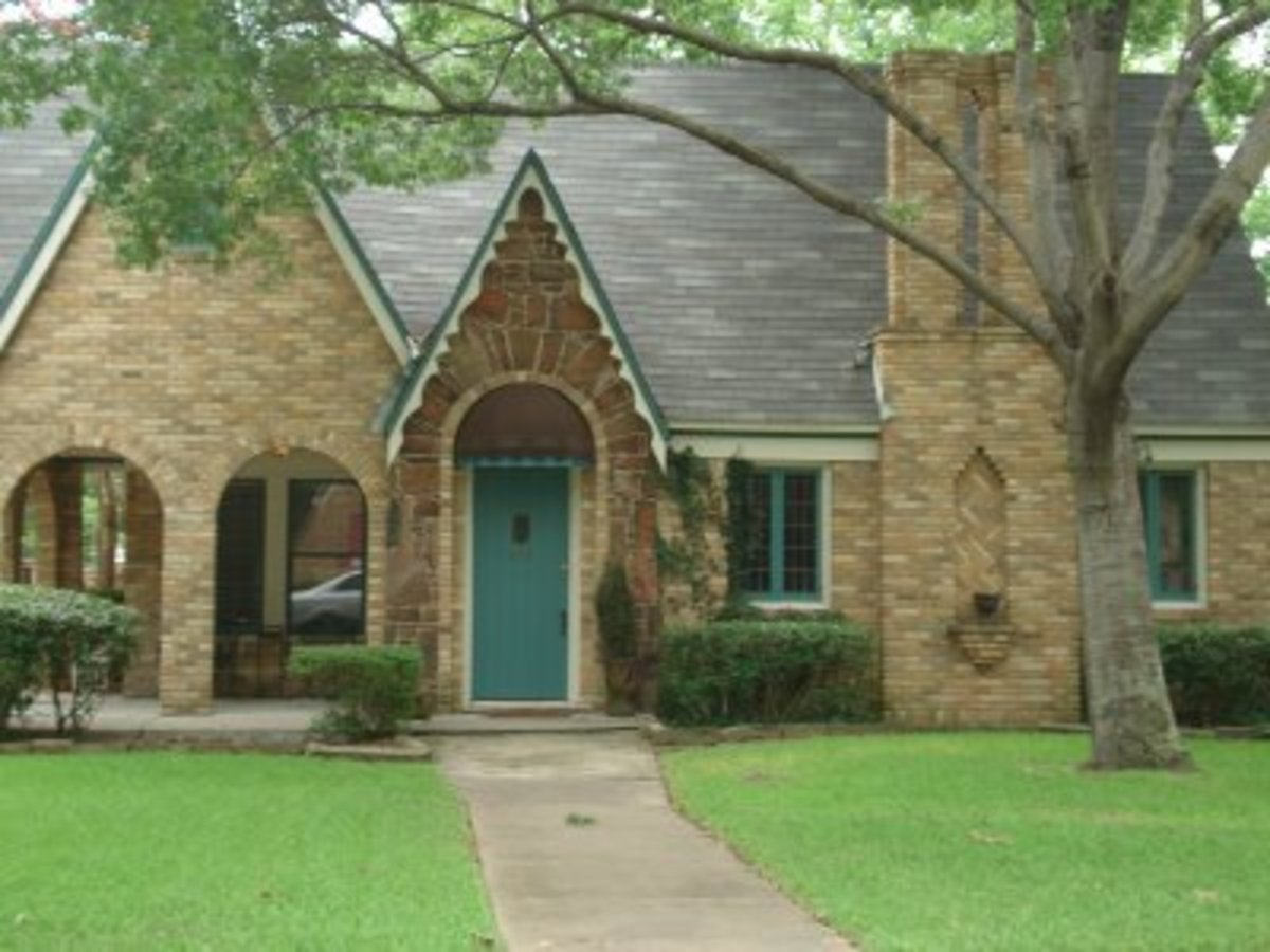 Home with a turquoise teal front door and window trim.