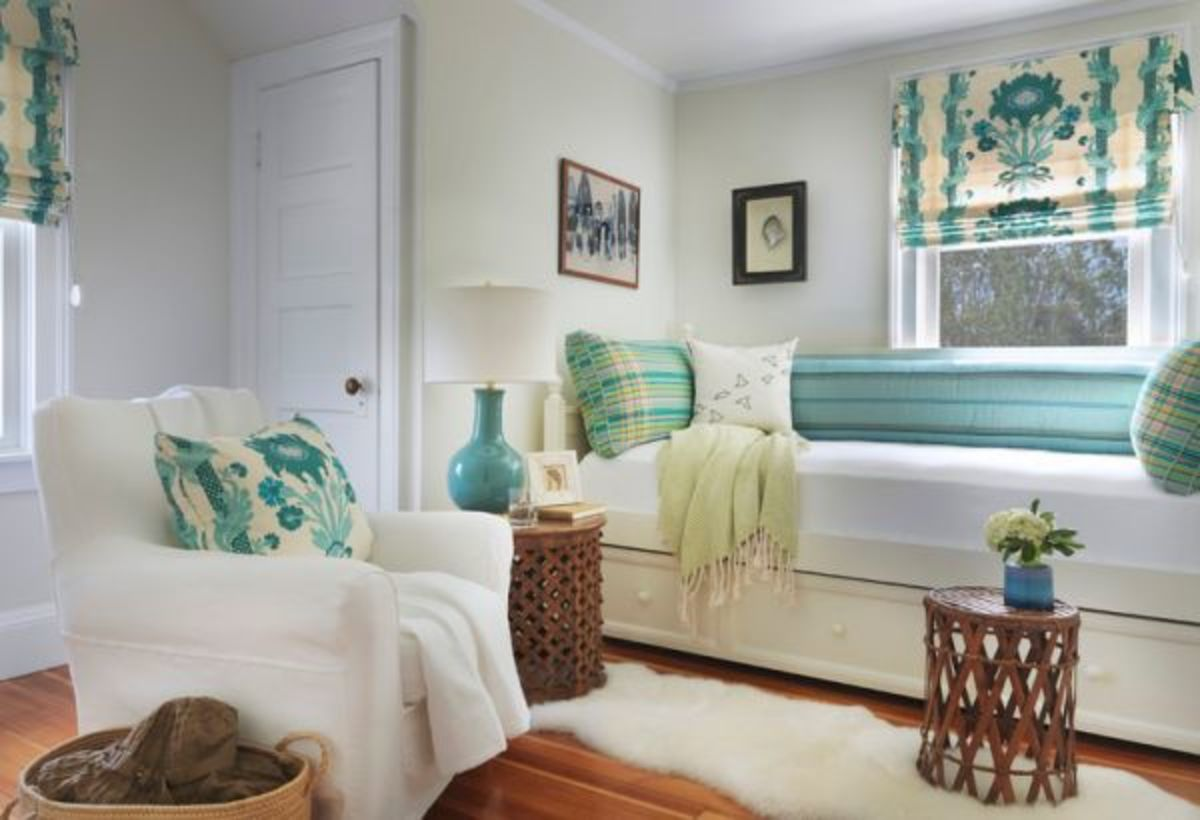 A beautiful room with white walls, white furniture and aqua/teal accents.