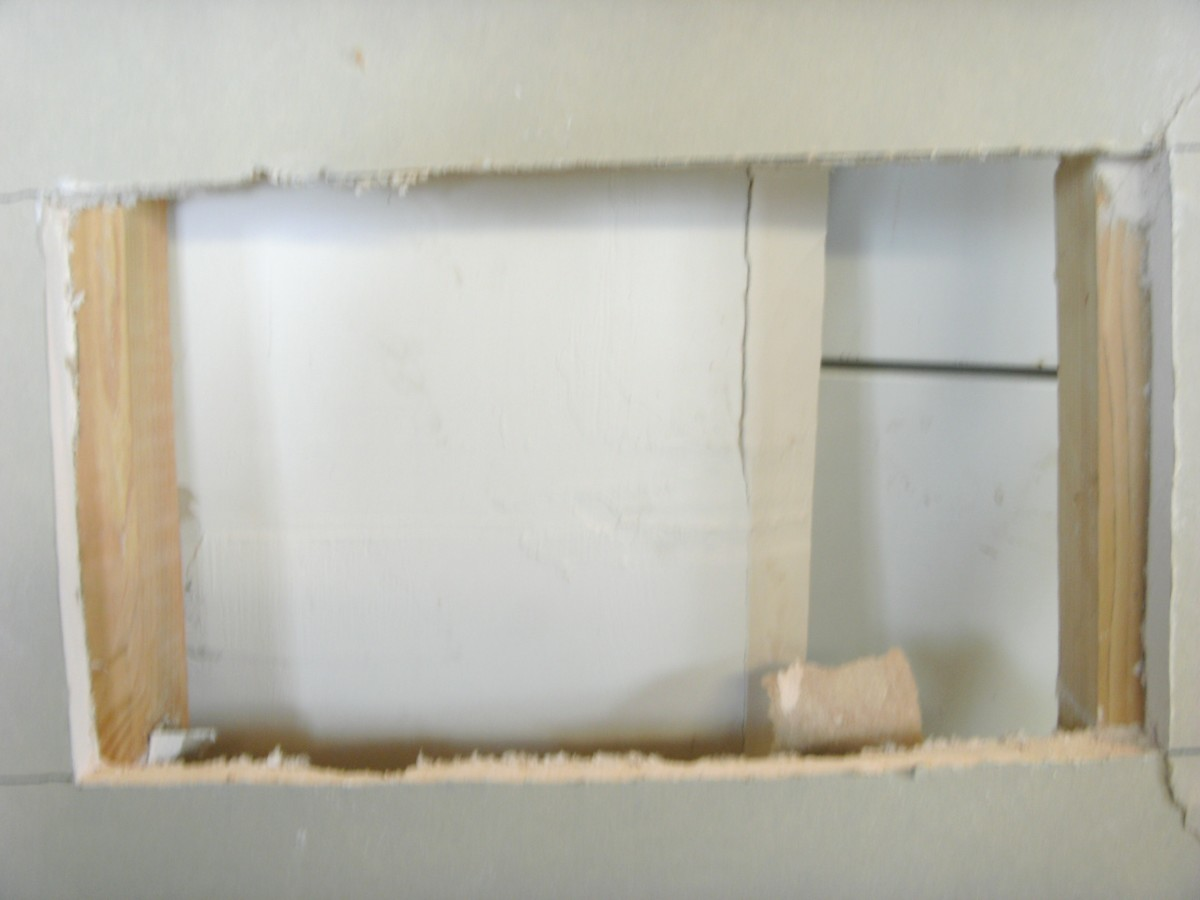 The square hole, clear over to the stud.