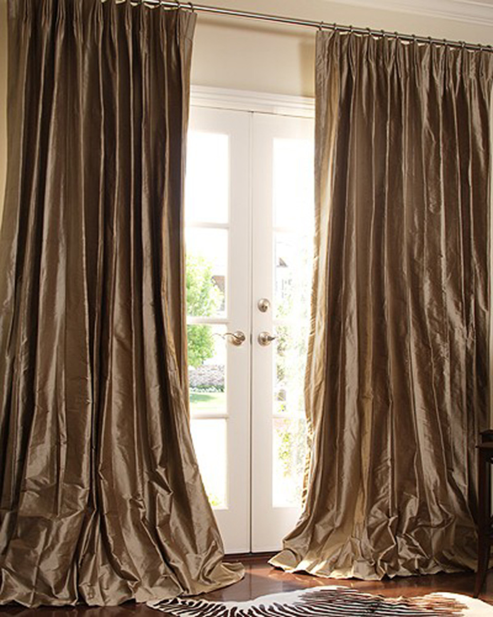 These curtains are most likely lined and interlined to add volume and protection from the sun.