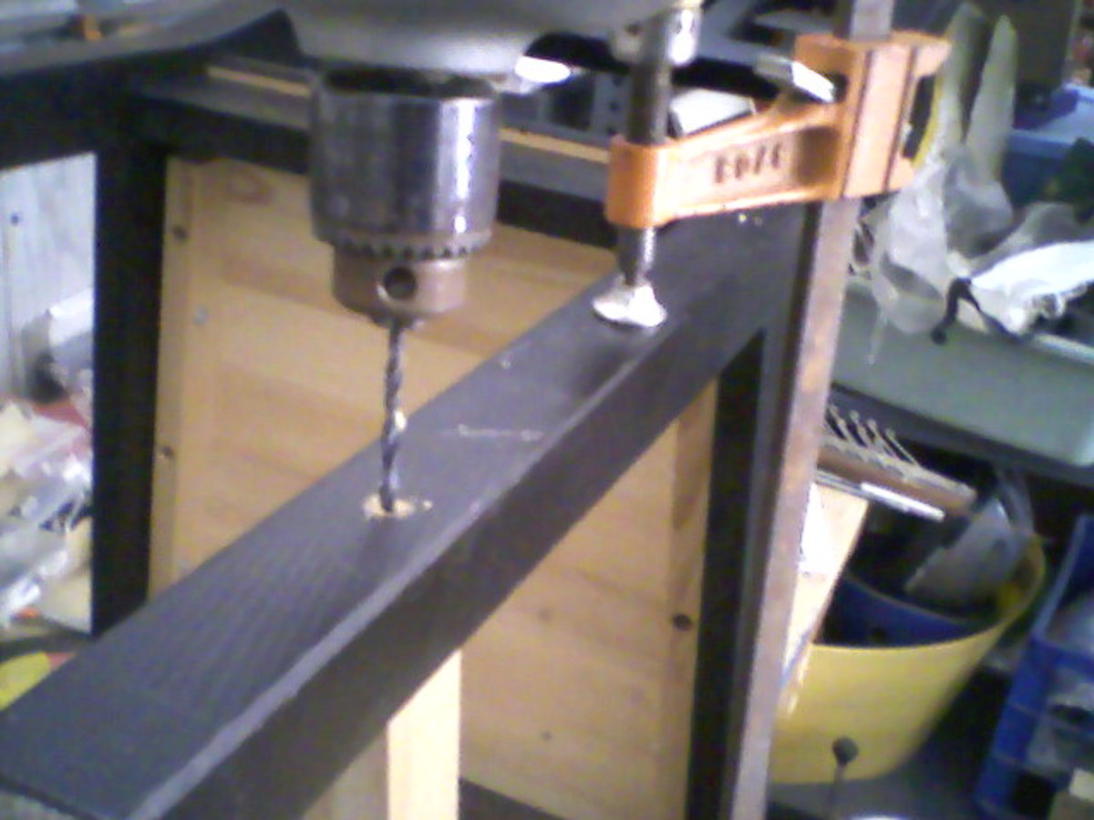 Drilling back into brace end.  Note use of bar clamp to help secure the brace for drilling.
