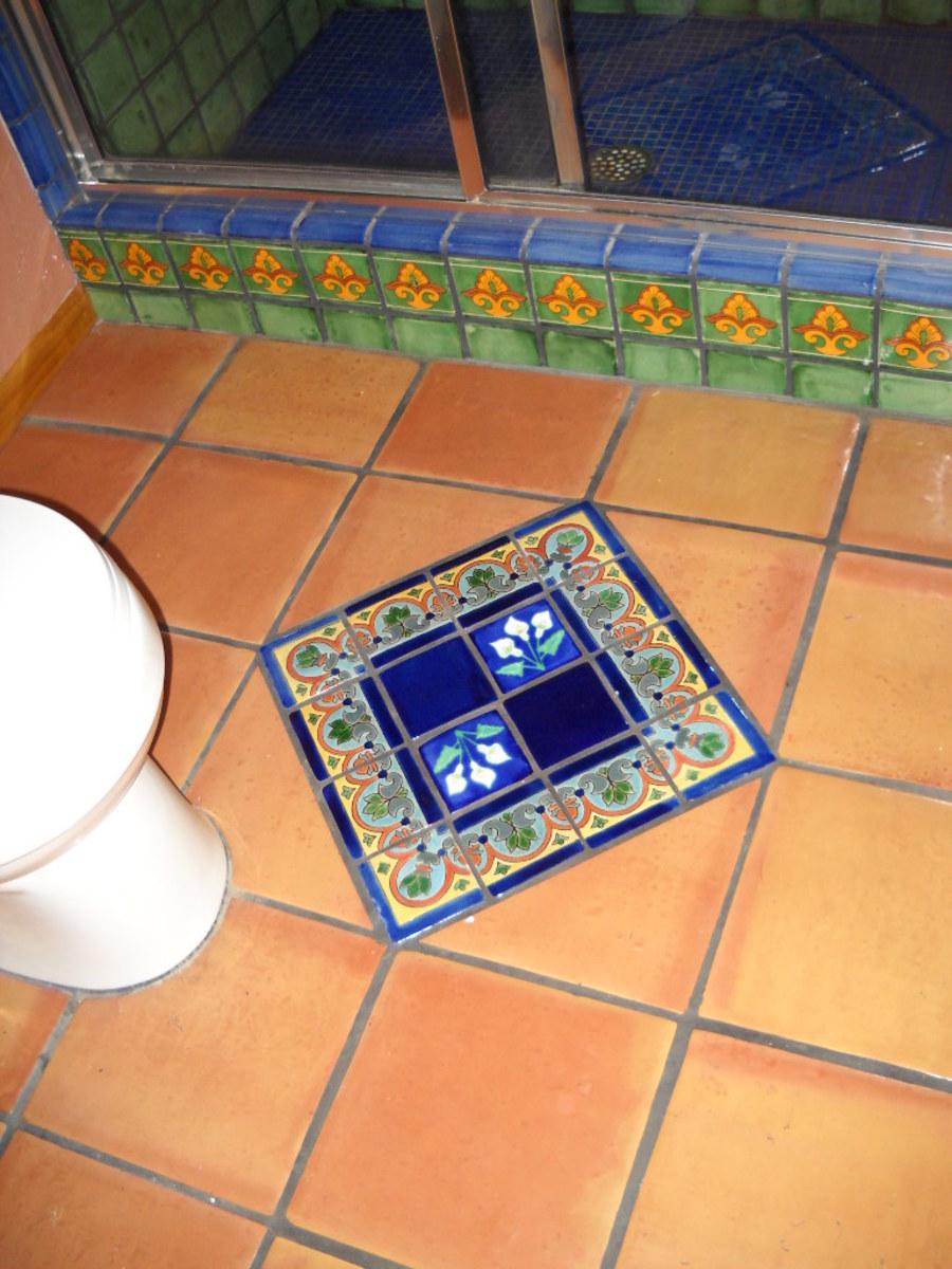 Blue talavera tile diamond set into floor.