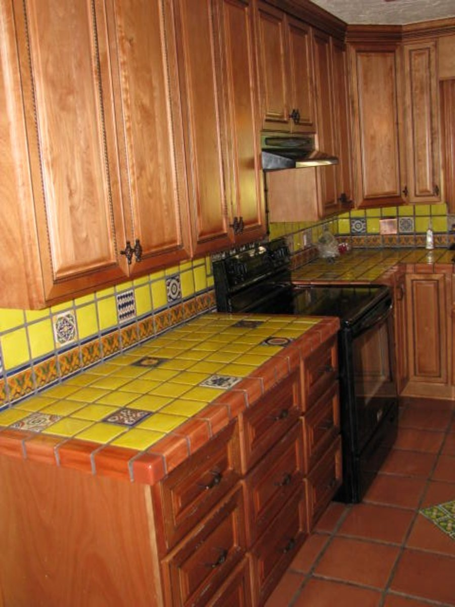 Yellow with multi-colored inset tiles and border.